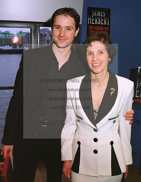 MRS ANTHONY ANDREWS, wife of the actor and her son MR JOSHUA ANDREWS, at a party in London on 8th April 1999.MPW 28