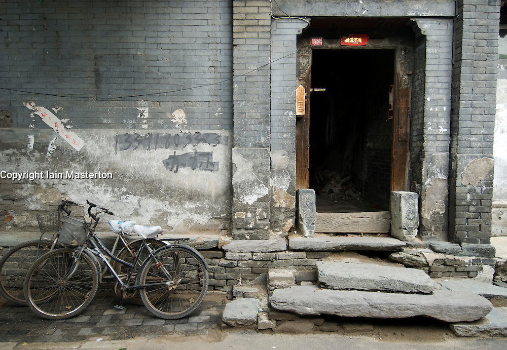 Detail of doorway to old house in a traditional historic Beijing hutong in Beijing