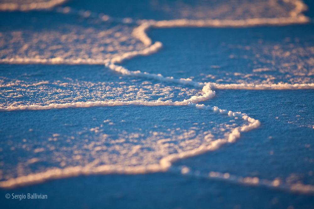 Patterns of the salt deposits in the Salar de Uyuni salt flat in south-western Bolivia during sunset.