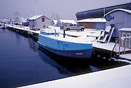 "The fishing boat ""Kathy"" is covered with snow as she's docked at the Thill's Fish Dock in Marquette, Mich."