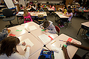 Students in Ms. Bergen's third grade class work on a writing assignment at Bennion Elementary School in Salt Lake City, Monday, Dec. 17, 2012.