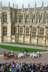 Princess Eugenie and her husband Jack Brooksbank travel in the Scottish State Coach during their carriage procession, following their wedding at St George's Chapel, Windsor Castle.