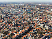 Nederland, Zuid-Holland, Gouda, 20-02-2012; zuidelijk gedeelte van de binnenstad met Gouwekerk, rechts Grote of Sint-Janskerk en op de Markt het gotische Stadhuis (r)..Gouda is bekend van de goudse kaas, kaarsen, pijpen en stroopwafels.The old town of  Gouda, with church and   gothic city hall (r). Gouda is famous for its cheese, candles, pipes and caramel waffles. .luchtfoto (toeslag), aerial photo (additional fee required) .copyright foto/photo Siebe Swart