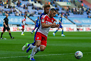 Wigan Michael Jacobs chases down Barnsley captain Mike Bahre during the EFL Sky Bet Championship match between Wigan Athletic and Barnsley at the DW Stadium, Wigan, England on 31 August 2019.