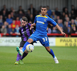 AFC Wimbledon's Kwesi Appiah is closed down by Bristol Rovers' Michael Smith - Photo mandatory by-line: Dougie Allward/JMP - Mobile: 07966 386802 05/04/2014 - SPORT - FOOTBALL - Kingston upon Thames - Kingsmeadow - AFC Wimbledon v Bristol Rovers - Sky Bet League Two