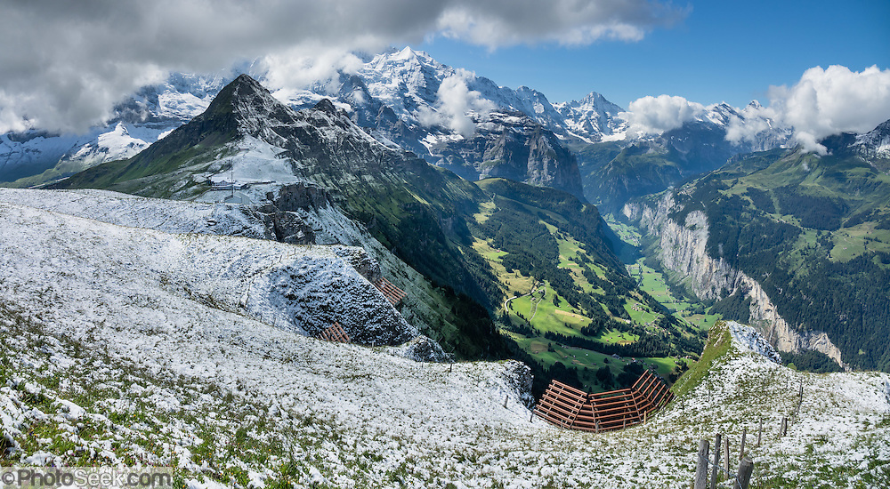 Snow in August on Männlichen Royal Walk, above Wengen and Lauterbrunnen Valley, Switzerland, the Alps, Europe. Jungfrau (13,642ft) rises 11,000 feet above Lauterbrunnen. This image was stitched from multiple overlapping photos.