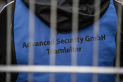 November 3, 2018 - Fuerstenfeldbruck, Bavaria, Germany - The vest of the A.S. security company in Unterfohring that handles the premises and is accused of violence and harassment of the residents100 .  Furthermore, an employee of this company attempted to confiscate the cameras and memory cards of a press photographer outside of the facility, despite no authority to do so. Migrants at the Fuerstenfeldbruck housing facility near Munich held a rally protesting alleging abuse by security staff and stays lasting two years or more instead of the maximum of six months.  The Fuerstenfeldbruck camp has been a flash point for conflicts for several years, with the predominantly African residents being involved in numerous altercations with security and staff.  Sources state that the migrants housed there have a low perspective to stay or pending deportation orders and such a situation, along with extended stays, leads to conflict. The group Refugee Struggle for Freedom recently released a partial video alleging an attack by several security workers against a resident. Upon return to the camp, an unrelated fight broke out requiring police and medical assistance.  It was at this point that a member of the security team approached a member of the press and aggressively demanded an end to photographing and also attempted to confiscate the cameras and memory cards.  The guard gave up the attempts when the photographer indicated that only the police can give such orders, which they did not. (Credit Image: © Sachelle Babbar/ZUMA Wire)