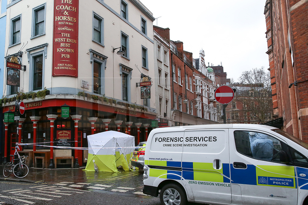 © Licensed to London News Pictures. 03/03/2019. London, UK. Police tent The Coach and Horses pub in Romilly Street in Soho. According to the police, a man aged 30 yrs old is seriously injured in hospital and a woman has been arrested. Photo credit: Dinendra Haria/LNP
