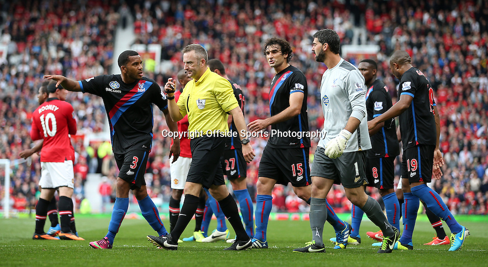 14th September 2013 - Barclays Premier League - Manchester United v Crystal Palace - Palace players surround and argue with referee Jon Moss - Photo: Simon Stacpoole / Offside.
