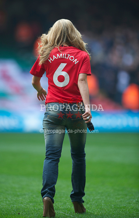 CARDIFF, WALES - Saturday, March 26, 2011: Miss Wales 2010 Courtenay Hamilton sings the national anthem before the UEFA Euro 2012 qualifying Group G match between Wales and England at the Millennium Stadium.  (Photo by David Rawcliffe/Propaganda)