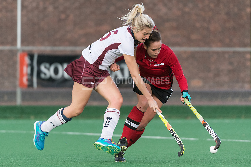Wimbledon's Mollie Rawnsley is tackled by Caity Wales of Southgate. Southgate v Wimbledon - Investec Women's Hockey League East Conference, Trent Park, London, UK on 25November 2017. Photo: Simon Parker