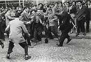 Paris 1955. Latin Quarter demonstrations. Policeman loses his hat in a struggle.<br /> <br /> Paris 1955. manifestations aux Quartier Latin. Le policier perd son chapeau dans la lutte .