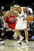 Apr 19, 2010; Cleveland, OH, USA; Cleveland Cavaliers guard Mo Williams (2) faces-off against Chicago Bulls guard Derrick Rose (1) during the third period in game two in the first round of the 2010 NBA playoffs at Quicken Loans Arena. The Cavaliers beat the Bulls 112-102. Mandatory Credit: Jason Miller-US PRESSWIRE