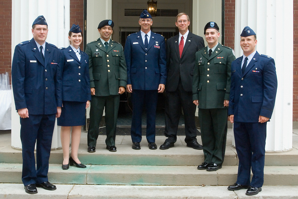 From left, Stephen Halla, Danielle Miller, Myro Lu, Director of CORE Faculty Development Steve Miller, Dean John Brose, Christopher Farabaugh and Christopher Strauchen.  Eight OU-COM graduates, including the five pictured, plan post-graduation practice at various U. S. Military medical installations.
