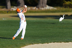 Feb 8, 2012; Pebble Beach CA, USA; Rickie Fowler hits his second shot on the second hole during the practice round of the AT&T Pebble Beach Pro-Am at Pebble Beach Golf Links. Mandatory Credit: Jason O. Watson-US PRESSWIRE