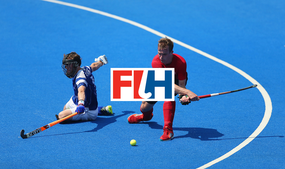 LONDON, ENGLAND - JUNE 20:  Gordan Johnston of Canada is blocked by Russell Anderson of Scotland during the Pool B match between Scotland and Canada on day six of the Hero Hockey World League Semi-Final at Lee Valley Hockey and Tennis Centre on June 20, 2017 in London, England.  (Photo by Alex Morton/Getty Images)
