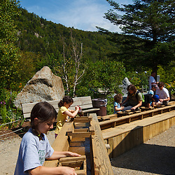 Kids pan for gold at Lost River Gorge in New Hampshire's White Mountains. North Woodstock.