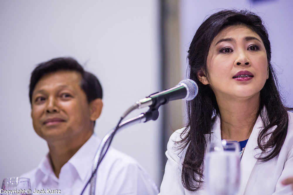 03 MARCH 2013 - BANGKOK, THAILAND: .PONGSAPAT PONGCHAREON, left, the Pheu Thai candidate for Governor of Bangkok, and YINGLUCK SHINAWATRA, the Thai Prime Minister, at the press conference announcing that Pongsapat lost the Bangkok Governor's election. Pongsapat Pongchareon, running on the Pheu Thai ticket, lost the Bangkok's Governor's race to MR Sukhumbhand Paribatra, the incumbent running on the Democrat ticket. Sukhumbhand won the race after scoring a record number of votes, more than 1.2 million to Pongsapat's 1 million. The results were seen as an upset even though Sukhumbhand was the incumbent because all of the pre-election polls and the exit polls conducted on election day showed Patsapong winning.     PHOTO BY JACK KURTZ