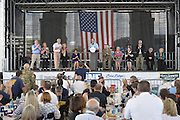 Gulfport, MS 8/28/15 President Bush addresses a group of Mississippi first responders during the 10th Anniversary Hurricane Katrina event in Gulfport. Mississippi Governor Phil Bryant checks the morning papers as he waits for  the 10th Anniversary Hurricane Katrina event. to begin. President George Bush joined Mississippi Governor's Haley Barbour and Governor Phil Bryant  for a first responders event to commemorate the 10th Anniversary of Hurricane Katrina in Gulfport Mississippi. Photo ©Suzi Altman