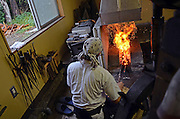 Japanese Swordsmith, Muneyasu, working at his studio in Saitama, Japan. He is part of the new generation of talented katana makers.