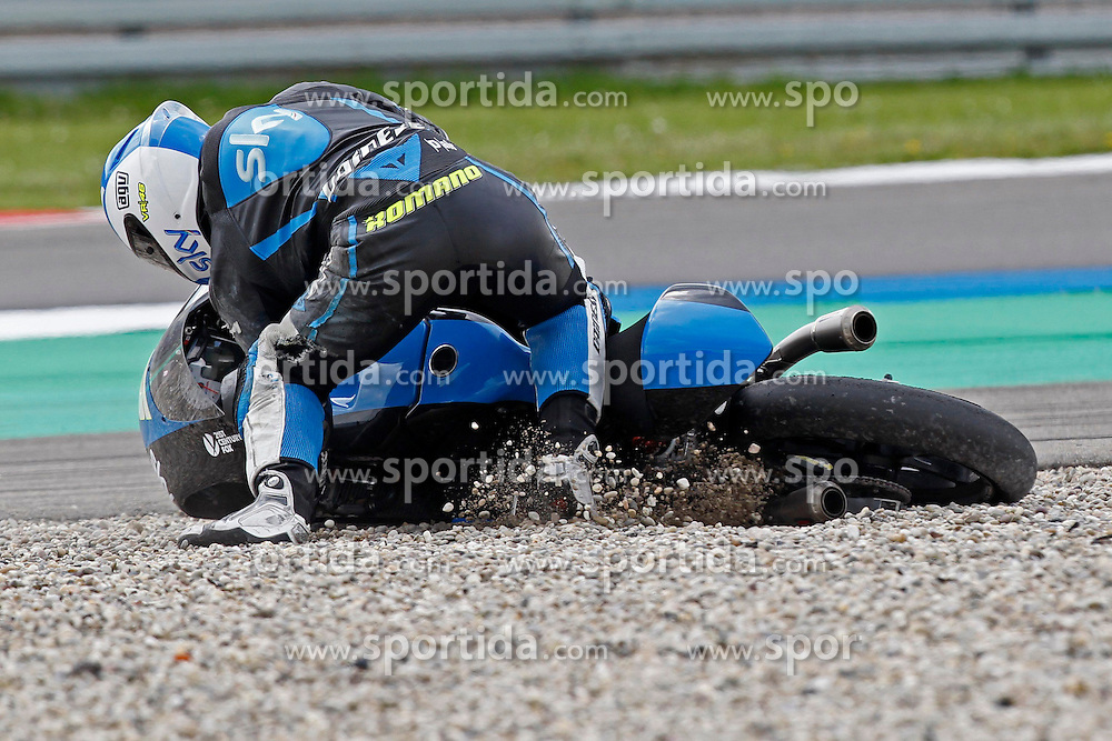 23.09.2012, TT Circuit, Assen, NED, MotoGP, Assen, im Bild Sturz 5 Romano Fenati // during the MotoGP Iveco TT Assen at the TT Circuit in Assen, Netherlands on 2012/09/23. EXPA Pictures &copy; 2014, PhotoCredit: EXPA/ Eibner-Pressefoto/ FOTO-SPO_AG<br /> <br /> *****ATTENTION - OUT of GER*****