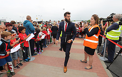 CARDIFF, WALES - Saturday, June 4, 2016: Wales' Joe Ledley and his team sign autographs for Ysgoal Treganna students as the team are given a colourful send off at Cardiff Airport as the squad head to Sweden for their last friendly before the UEFA Euro 2016 in France. (Pic by David Rawcliffe/Propaganda)