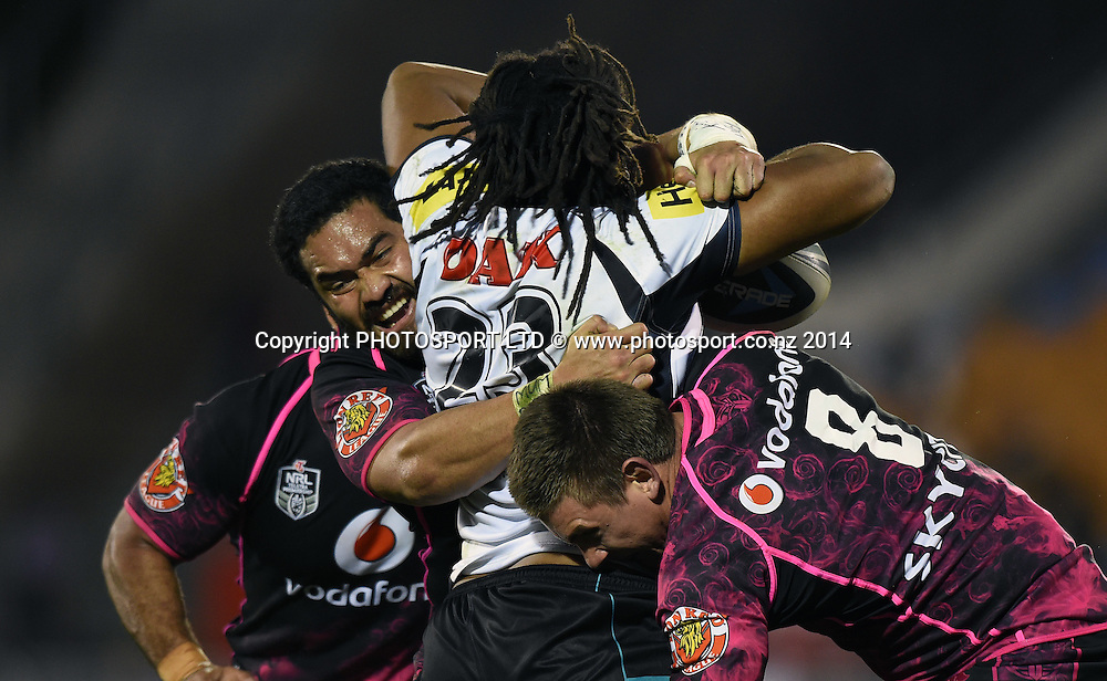 Konrad Hurrell and Jacob Lillyman tackle Jamal Idris. Vodafone Warriors v Penrith Panthers. NRL Rugby League. Mt Smart Stadium, Auckland, New Zealand. Sunday 29 June 2014. Photo: Andrew Cornaga/www.Photosport.co.nz