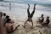 BALI, INDONESIA; APRIL 26, 2015: Tourists spend time at Jimbaran beach on Sunday, April 26, 2015.
