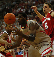 MORNING JOURNAL/DAVID RICHARD.Greg Oden battles for a rebound against Kammron Taylor left, and  Jason Chappell Sunday, Feb. 25, 2007, in Columbus, Ohio. Ohio State beat Wisconsin 49-48.