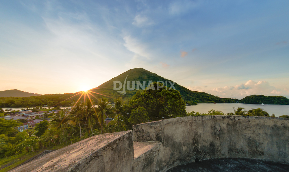 Fort Belgica commands a view of Banda Neira, surrounding waterways, and nearby islands in the Banda Archipelago, including Gunung Api volcano.