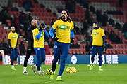 Matias Ezequiel Schelotto (21)  of Brighton and Hove Albion warming up wearing a kick it out shirt ahead of the Premier League match between Bournemouth and Brighton and Hove Albion at the Vitality Stadium, Bournemouth, England on 21 January 2020.