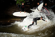 The surfing scene in landlocked Munich, Germany depends on a standing wave in the Eisbach, a man-made tributary of the Isar River.  Surfing the Eisbach is technically illegal but is tolerated by local authorities and has given rise to local talents.