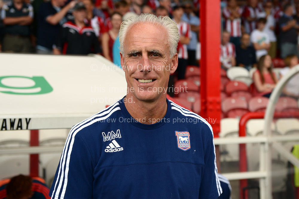 Mick McCarthy, the Ipswich Town manager smiles as he arrives at the dugout before k/o. Skybet football league Championship match, Brentford v Ipswich Town at Griffin Park in London on Saturday 8th August 2015.<br /> pic by John Patrick Fletcher, Andrew Orchard sports photography.