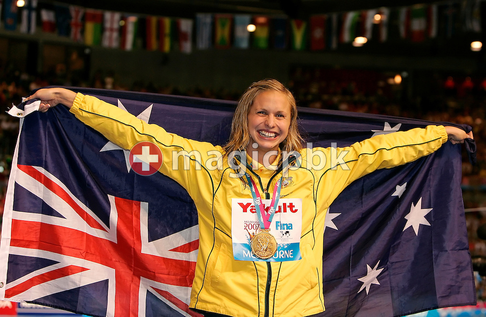 Lisbeth (Libby) Lenton of Australia is pictured with her gold medal and national flag after the award ceremony for the womens's 50m freestyle final in the Susie O'Neill pool at the FINA Swimming World Championships in Melbourne, Australia, Sunday 1 April 2007. (Photo by Patrick B. Kraemer / MAGICPBK)