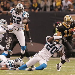 2008 December, 28: New Orleans Saints wide receiver Lance Moore (16) breaks away from a tackle by Carolina Panthers cornerback Chris Gamble (20) during a week 17 game between NFC South divisional rivals the Carolina Panthers and the New Orleans Saints at the Louisiana Superdome in New Orleans, LA.