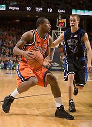 Virginia guard Jeff Jones (1) is guarded by Duke guard Jon Scheyer (30).  The Virginia Cavaliers men's basketball team fell to the #6 Duke Blue Devils 86-70 at the University of Virginia's John Paul Jones Arena in Charlottesville, VA on March 5, 2008.