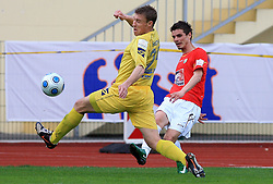 Ivan Knezovic of Domzale vs Alem Mujakovic of Rudar  at 26th Round of Slovenian First League football match between NK Domzale and NK Rudar Velenje in Sports park Domzale, on April 4, 2009, in Domzale, Slovenia. (Photo by Vid Ponikvar / Sportida)