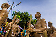 28 JUNE 2014 - DAN SAI, LOEI, THAILAND: Men covered in mud from the Mun River during the Ghost Festival parade in Dan Sai. Phi Ta Khon (also spelled Pee Ta Khon) is the Ghost Festival. Over three days, the town's residents invite protection from Phra U-pakut, the spirit that lives in the Mun River, which runs through Dan Sai. People in the town and surrounding villages wear costumes made of patchwork and ornate masks and are thought be ghosts who were awoken from the dead when Vessantra Jataka (one of the Buddhas) came out of the forest.    PHOTO BY JACK KURTZ