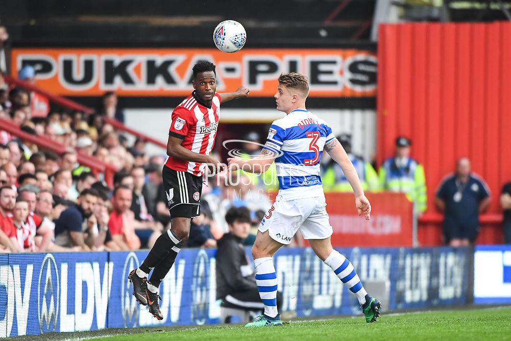 Brentford Midfielder Florian Jozefzoon (7) and Queens Park Rangers Defender Jake Bidwell (3) in action during the EFL Sky Bet Championship match between Brentford and Queens Park Rangers at Griffin Park, London, England on 21 April 2018. Picture by Stephen Wright.