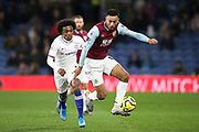 Burnley midfielder Dwight McNeil (11) chased by Chelsea midfielder Willian (10) during the Premier League match between Burnley and Chelsea at Turf Moor, Burnley, England on 26 October 2019.