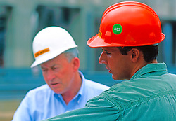 Construction Engineers, Operators, Workers Operating Industrial Equipment Power Plants