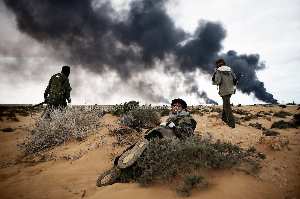 LIBYA, BIN JAWAD: Rebels fighting against pro-Gadafy troupes, on March 11, 2011. ALESSIO ROMENZI