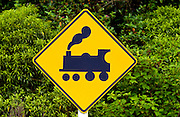 Road traffic sign look out for trains on railway crossing, North Island, New Zealand