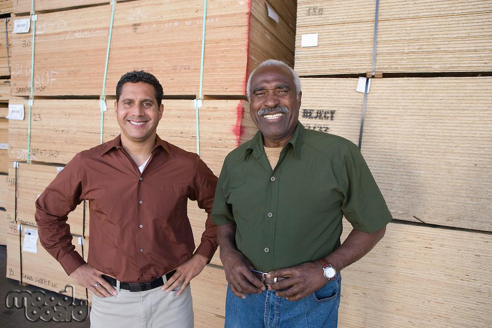 Men in warehouse, portrait