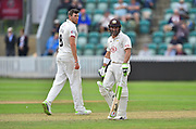Dean Elgar of Surrey and Jamie Overton of Somerset during the opening day of the Specsavers County Champ Div 1 match between Somerset County Cricket Club and Surrey County Cricket Club at the Cooper Associates County Ground, Taunton, United Kingdom on 18 September 2018.