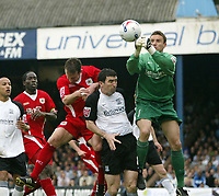 Photo: Chris Ratcliffe.<br />Southend United v Bristol City. Coca Cola League 1. 06/05/2006.<br />Louis Carey (L) of Bristol City challenges Kevin Maher (C) and Darryl Flahavan (keeper) of Southend for the ball.