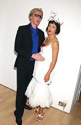Milliner PHILIP TREACY and ISABELLA BLOW at the launch of 'Blow Lips' a new lipstick by Isabella Blow and MAC Makeup held at the the Blow de la Barra Gallery, 35 Heddon Street, London on 7th September 2005.<br />