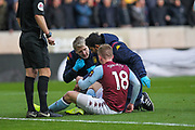 Matt Targett of Aston Villa receives treatment during the Premier League match between Wolverhampton Wanderers and Aston Villa at Molineux, Wolverhampton, England on 10 November 2019.