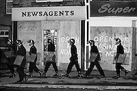 Police in riot gear patrol Grimethorpe during the 1984 miners strike. Nov 1984...&copy; Martin Jenkinson<br />