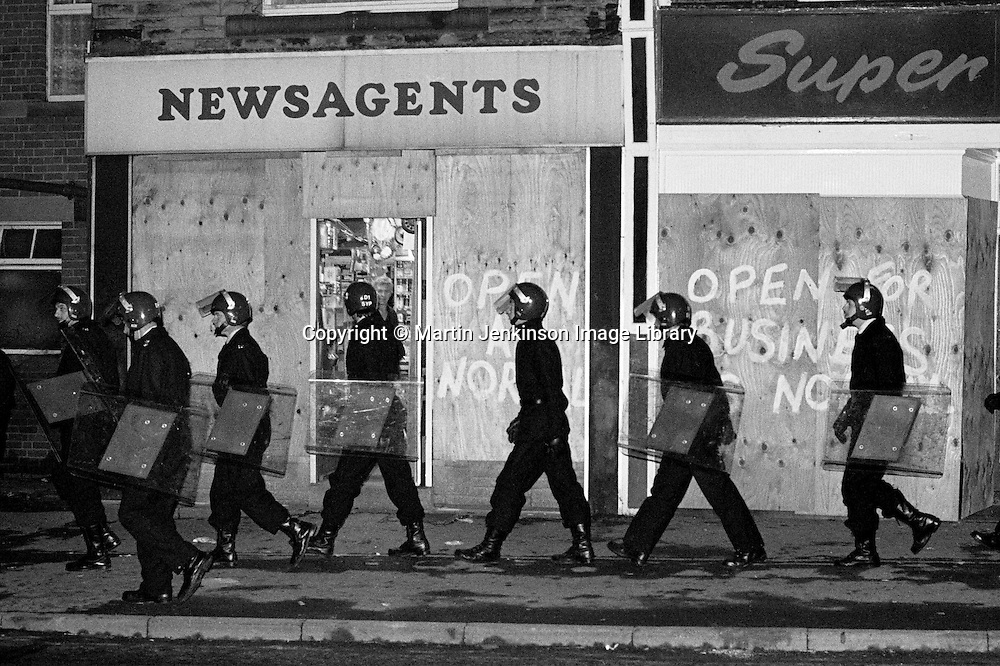 Police in riot gear patrol Grimethorpe during the 1984 miners strike. Nov 1984...&copy; Martin Jenkinson<br /> email martin@pressphotos.co.uk  NUJ recommended terms &amp; conditions apply. Copyright Designs &amp; Patents Act 1988. Moral rights asserted credit required. No part of this photo to be stored, reproduced, manipulated or transmitted by any means without prior written permission.
